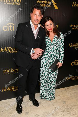 """Ricky Paull Goldin, left, and Gretta Monahan, right, attend The Hollywood Reporter's """"35 Most Powerful People in Media"""" celebration at the Four Seasons Restaurant, in New York"""