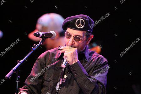 Stock Image of Lee Oskar of War performing at Chastain Park Amphitheatre, in Atlanta