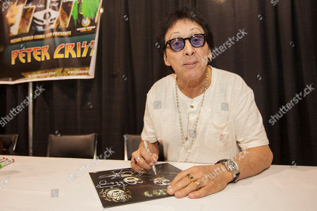 Musician Peter Criss, of the rock band Kiss, signs autographs during the Wizard World Chicago Comic Con at the Donald E. Stephens Convention Center in Rosemont, IL on