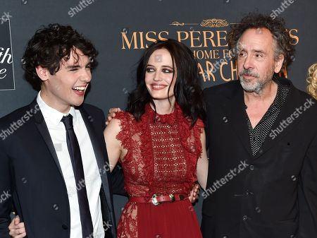 """Actor Finlay MacMillan, left, actress Eva Green and director Tim Burton attend """"Miss Peregrine's Home for Peculiar Children"""" red carpet event at Saks 5th Avenue, in New York"""
