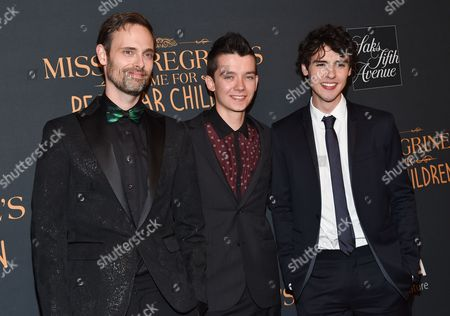 """Author Ransom Riggs, left, actor Asa Butterfield and actor Finlay MacMillan attend """"Miss Peregrine's Home for Peculiar Children"""" red carpet event at Saks 5th Avenue, in New York"""