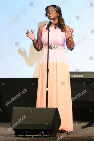 Stock Picture of Angie Fisher performs on stage during the Black Aids Institute's 16th Annual Heroes in the Struggle Gala held at the Directors Guild of America, in Los Angeles