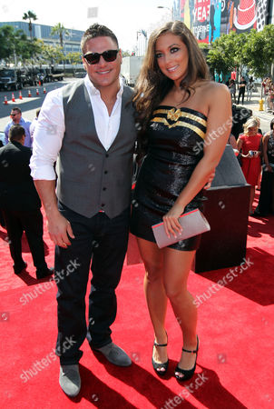"""Ronnie Ortiz-Magro, left, and Samantha Giancola from MTV's """"Jersey Shore,"""" arrive at the MTV Video Music Awards, in Los Angeles"""