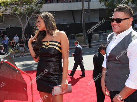 Ronnie Ortiz-Magro, right, and Samantha Giancola arrive at the MTV Video Music Awards, in Los Angeles