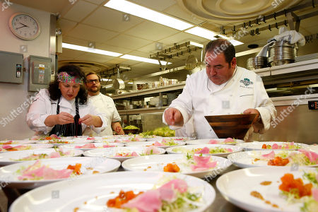 IMAGE DISTRIBUTED FOR JAMES BEARD FOUNDATION - Chef Carrie Nahabedian and Chef Emeril Lagasse prepare a dish at the 2014 James Beard Foundation Gala: Celebrating Charlie Trotter and the New American Cuisine at the Four Seasons Restaurant, on in New York