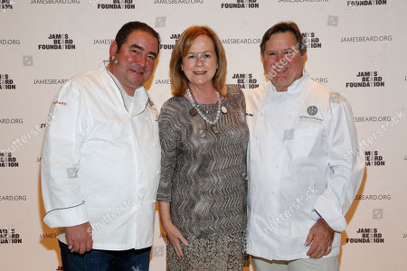 Stock Photo of IMAGE DISTRIBUTED FOR JAMES BEARD FOUNDATION - Chef Emeril Lagasse, JBF President Susan Ungaro, and Norman Van Aken seen at the 2014 James Beard Foundation Gala: Celebrating Charlie Trotter and the New American Cuisine at the Four Seasons Restaurant, on in New York