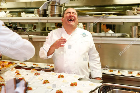 Stock Image of Chef Emeril Lagasse seen at the 2014 James Beard Foundation Gala: Celebrating Charlie Trotter and the New American Cuisine at the Four Seasons Restaurant, on in New York