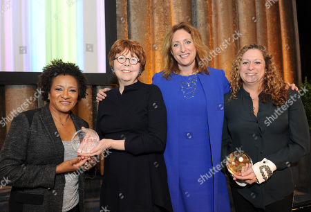 Honorees Wanda Sykes, left, Mary Bailey and Abigail Disney, right, pose with host Judy Gold, second right, at the 34th annual Muse Awards presented by New York Women in Film & Television (NYWIFT), in New York. The Muse Awards recognize the outstanding vision and achievement of women in film, television and digital media industries
