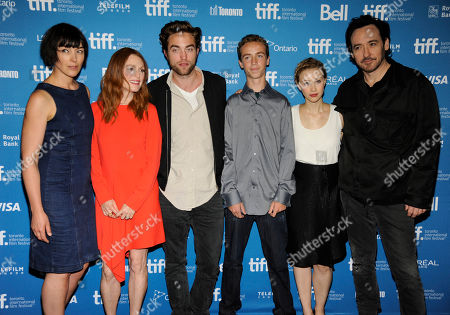 "Stock Photo of Olivia Williams, from left, and Julianne Moore, Robert Pattinson, John Cusack, Evan Bird and Sarah Gadon attend the press conference for ""Maps to the Stars"" on day 6 of the Toronto International Film Festival at the TIFF Bell Lightbox, in Toronto"