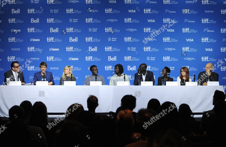 """Moderator Richard Crouse and from left, Philippe Falardeau, Reese Witherspoon, Arnold Oceng, Emmanuel Jal, Ger Duany, Kuoth Wiel, Margaret Nagle and Corey Stoll attend the press conference for """"The Good Lie"""" on day 5 of the Toronto International Film Festival at the TIFF Bell Lightbox, in Toronto"""