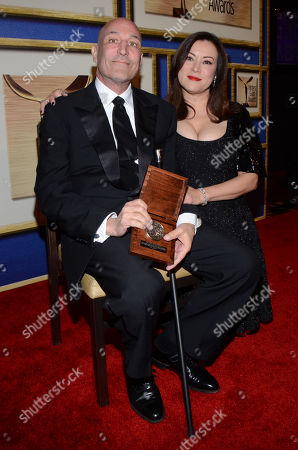 Sam Simon, left, poses in the press room with Jennifer Tilly with his Valentine Davies award at the Writers Guild Awards,, in Los Angeles