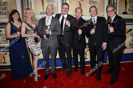 "From left, Gennifer Hutchinson, Moira Walley-Beckett, Sam Catlin, Vince Gilligan, Thomas Schnauz, George Mastras and Peter Gould pose in the press room with the outstanding drama series award for ""Breaking Bad"" at the Writers Guild Awards,, in Los Angeles"