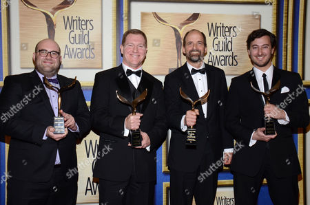 """Stock Image of From left, Charlie Sanders, Ian Roberts, Jay Martel and Alex Rubens pose in the press room with the outstanding script comedy/variety specials award for """"Blake Shelton's Not So Family Christmas"""" at the Writers Guild Awards,, in Los Angeles"""