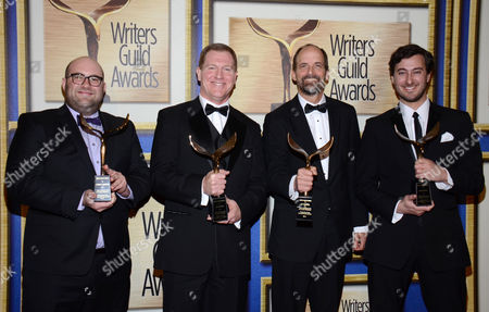 """From left, Charlie Sanders, Ian Roberts, Jay Martel and Alex Rubens pose in the press room with the outstanding script comedy/variety specials award for """"Blake Shelton's Not So Family Christmas"""" at the Writers Guild Awards,, in Los Angeles"""