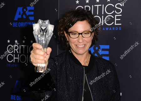 Lisa Cholodenko poses in the press room with the award for best limited series for â?oeOlive Kitteridgeâ?? at the Critics' Choice Television Awards at the Beverly Hilton hotel, in Beverly Hills, Calif