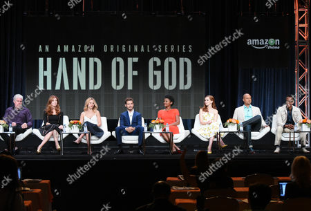 """Ron Perlman, from left, Dana Delany, Alona Tal, Julian Morris, Emayatzy Corinealdi, Elizabeth McLaughlin, Ben Watkins and Andre Royo participate in the """"Hand of God"""" panel at the Amazon Summer TCA Tour at the Beverly Hilton Hotel, in Beverly Hills, Calif"""