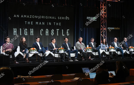 "Luke Kleintank, from left, Alexa Davalos, Rupert Evans, Rufus Sewell, Joel de la Fuente, Cary-Hiroyuki Tagawa, DJ Qualls and producers Isa Dick Hackett, David W. Zucker and Frank Spotnitz participate in ""The Man in the High Castle"" panel at the Amazon Summer TCA Tour at the Beverly Hilton Hotel, in Beverly Hills, Calif"