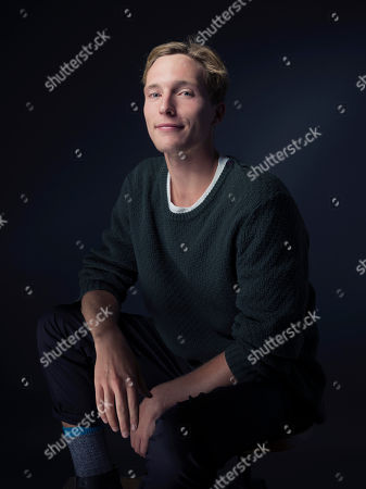 """Sean Keenan poses for a portrait to promote the film, """"Strangerland"""", at the Eddie Bauer Adventure House during the Sundance Film Festival, in Park City, Utah"""