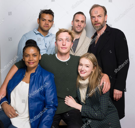 """Meyne Wyatt, from top left to bottom right, Joseph Fiennes, Hugo Weaving, Lisa Flanagan, Sean Keenan and Maddison Brown pose for a portrait to promote the film, """"Strangerland"""", at the Eddie Bauer Adventure House during the Sundance Film Festival, in Park City, Utah"""
