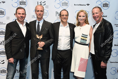 Michel Litvak, from left, Director Dan Gilroy, Gary Michael Walters, Jennifer Fox, and David Lancaster pose with the award for best first feature for Nightcrawler in the press room at the 30th Film Independent Spirit Awards, in Santa Monica, Calif