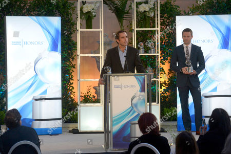 "Bob Woodruff, left, accepts the Television Academy award for ""E:60 Dream On: Stories of Boston's Strongest."" Andy Tennant, looks on from right, at the 8th annual Television Academy Honors at the Montage hotel, in Beverly Hills, Calif"