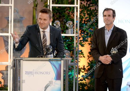 "Andy Tennant, left, accepts the Television Academy Honors award for ""E:60 Dream On: Stories of Boston's Strongest."" Bob Woodruff, looks on from right, at the 8th annual Television Academy Honors at the Montage hotel, in Beverly Hills, Calif"