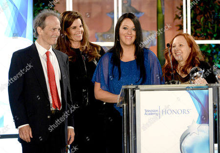 """Nick Doob, from left, Maria Shriver, Katrina Gilbert and Shari Cookson accept a Television Academy Honors award for """"Paycheck to Paycheck: The Life and Times of Katrina Gilbert"""" at the 8th annual Television Academy Honors at the Montage hotel, in Beverly Hills, Calif"""