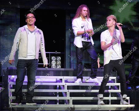 AUGUST 03: (L-R) Heejun Han,Deandre Brackensick and Carlton Dixon perform during American Idols Live at BankAtlantic Center on in Sunrise, Florida