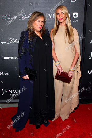 Lorraine Schwartz, left, and Ofira Sandberg, right, arrive at Gabrielle's Angel Foundation For Cancer Research Angel Ball 2015 at Cipriani Wall Street, in New York