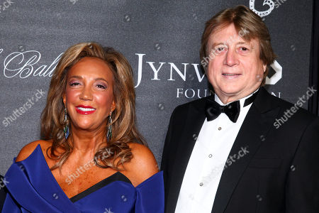 Denise Rich, left, and Peter Cervinka, right, arrive at Gabrielle's Angel Foundation For Cancer Research Angel Ball 2015 at Cipriani Wall Street, in New York