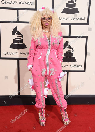 Dencia arrives at the 58th annual Grammy Awards at the Staples Center, in Los Angeles