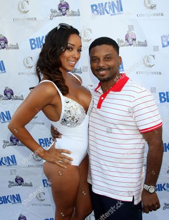 Gloria Govan and Carl Payne pose on the carpet at Bikini Swim Club Gloria Govan Edition at the Custom Hotel, in Los Angeles