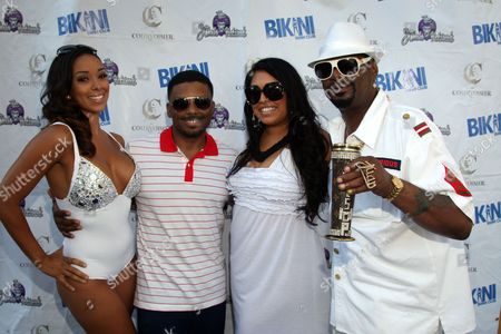"L-R) Gloria Govan, Carl Payne, Gabriela Cardenas and Bishop Don ""Magic"" Juan pose on the carpet at Bikini Swim Club Gloria Govan Edition at the Custom Hotel, in Los Angeles"