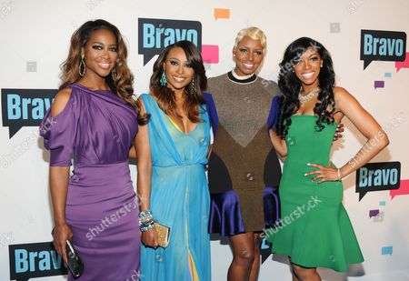 """The Real Housewives of Atlanta"""" cast members, from left, Kenya Moore, Cynthia Bailey, NeNe Leakes and Porsha Stewart attend the Bravo Network 2013 Upfront on in New York"""