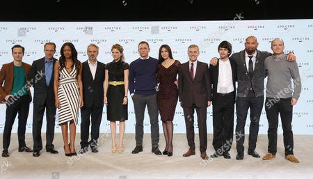 Actors Andrew Scott, Ralph Fiennes, Naomie Harris, Director Sam Mendes, Lea Seydoux, Daniel Craig, Monica Belluci, Christoph Waltz, Ben Whishaw, Dave Bautista and Rory Kinnear pose for photographers at the announcement for the new Bond film, the 24th in the series, at Pinewood Studios in west London