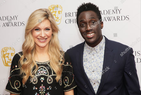 Presenters Naomi Wilkinson and Andy Akinwolere pose for photographers as they arrive for the British Academy Children's Awards in London