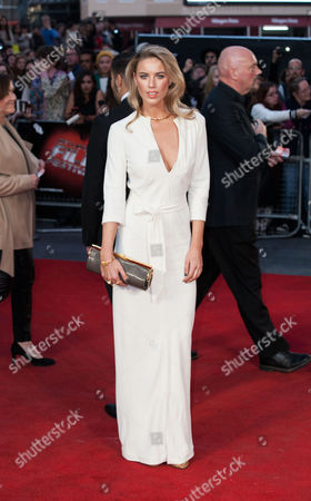 Actress Alexandra Weaver poses for photographers upon arrival at the Premiere of the film High-Rise, showing as part of the London Film Festival, in central London