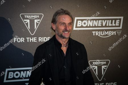 Carl Fogarty poses for photographers upon arrival at the Triumph Motorcycles VIP launch party, in London
