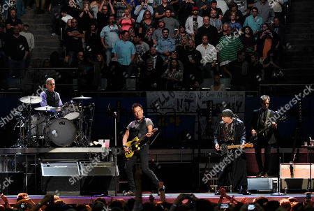 Bruce Springsteen, second from left, performs with E Street Band members, from left, Max Weinberg, Steven Van Zandt and Garry Tallent during their concert at the Los Angeles Sports Arena, in Los Angeles