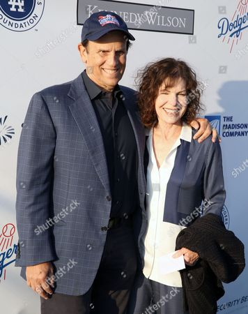 Michael Milken, left, and Lori Anne Hackel attend the Los Angeles Dodgers Foundation Blue Diamond Gala at Dodgers Stadium, in Los Angeles