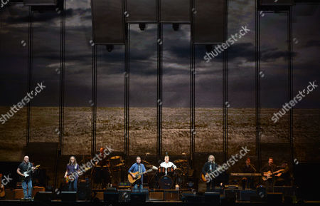 "From left, Bernie Leadon, Timothy B. Schmit, Glenn Frey, Don Henley, and Joe Walsh of The Eagles perform on the ""History of the Eagles"" tour at the Forum, on in Los Angeles"
