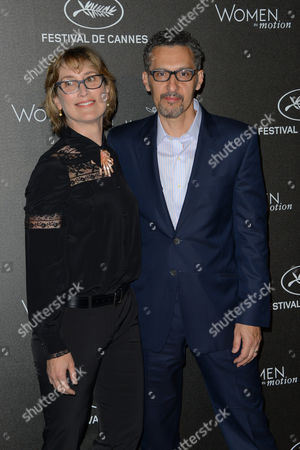 Katherine Borowitz and John Turturro pose for photographers upon arrival at the Women in Motion Honor Awards, at the 68th international film festival, Cannes, southern France