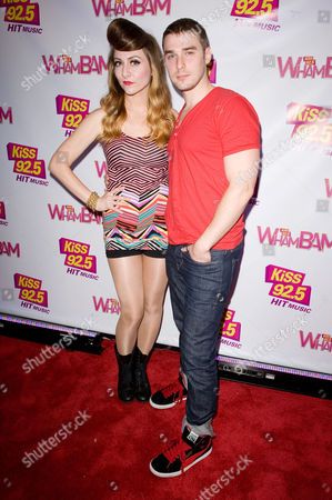 Singers Amy Heidemann, left, and Nick (Louis) Noonan of Karmin arrive on the red carpet during the KiSS 92.5 Wham Bam at the Molson Amphitheatre, in Toronto