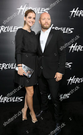 """From left, actors Barbara Palvin and Aksel Hennie arrive for the premiere of """"Hercules"""" held at the TCL Chinese Theatre, in Los Angeles, Calif"""
