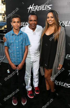 """From left, Daniel Ray Leonard, Sugar Ray Leonard and Camille Leonard arrive for the premiere of """"Hercules"""" held at the TCL Chinese Theatre, in Los Angeles, Calif"""