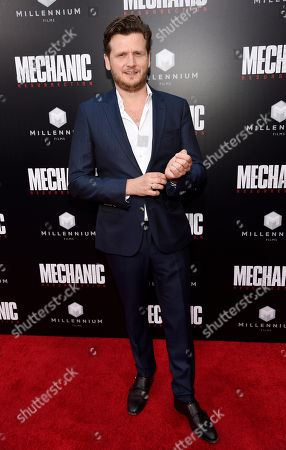 """Dennis Gansel, director of """"Mechanic: Resurrection,"""" poses at the premiere of the film at the ArcLight Hollywood, in Los Angeles"""