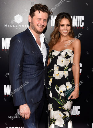 """Dennis Gansel, left, director of """"Mechanic: Resurrection,"""" poses with cast member Jessica Alba at the premiere of the film at the Arclight Hollywood, in Los Angeles"""