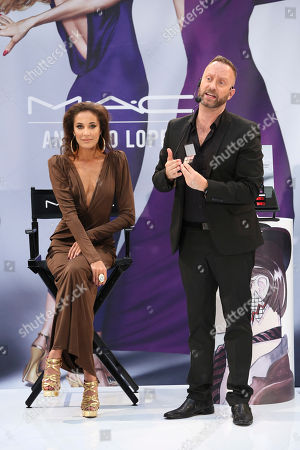 From right, Gregory Arlt, Director of Makeup Artistry for MAC Cosmetics presents with model Angelina McCoy during the MAC Cosmetics media event at South Coast Plaza, in Costa Mesa, Calif