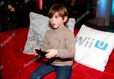 Actor Alexander James Rodriguez warms up and checks out Wii U at the Nintendo Lounge during a break from the Sundance Film Festival on in Park City, Utah