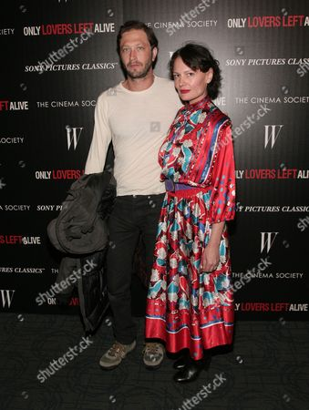 "Actor Ebon Moss-Bachrach, left, and photographer Yelena Yemchuk, right, attend a screening of ""Only Lovers Left Alive"" hosted by the Cinema Society and W Magazine on in New York"